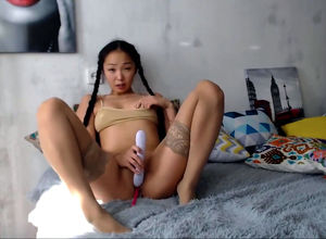 Appetizing chinese cutie with wand..