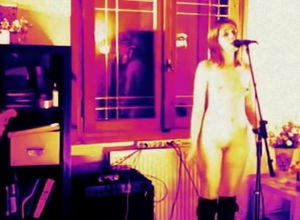 Nude woman singing